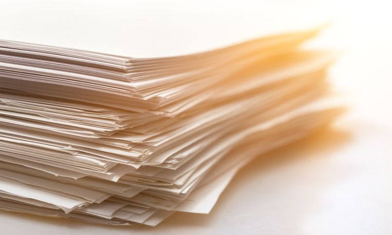 stack of papers against a white backgorund